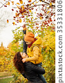 Autumn Family in Fall Park Outdoors. 35331806