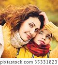 Autumn Portrait of Happy Family. Loving Mother  35331823