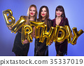 Three beautiful elegant women celebrate birthday  35337019