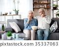 Senior man and woman viewing TV at home 35337063