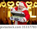 Happy Santa Claus on blurred background. 35337783