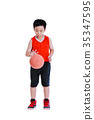 Young asian boy playing with a basketball.  35347595