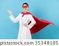 woman clinic doctor wearing superhero clothing 35348105