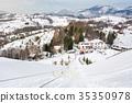 Vintage ski lift on snowy mountain 35350978