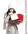Happy young woman with Christmas present box 35354655