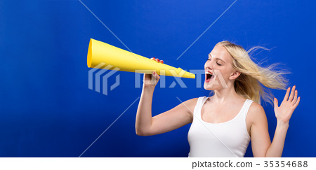 Young woman holding a paper megaphone  35354688