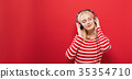 Happy young woman with headphones 35354710