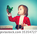 Happy toddler girl with Christmas gift box 35354727