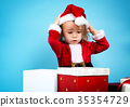 Happy toddler girl with Christmas gift boxes 35354729