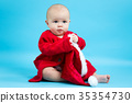 Baby girl in a Santa costume 35354730
