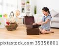 little girl children opening vintage suitcase 35356801