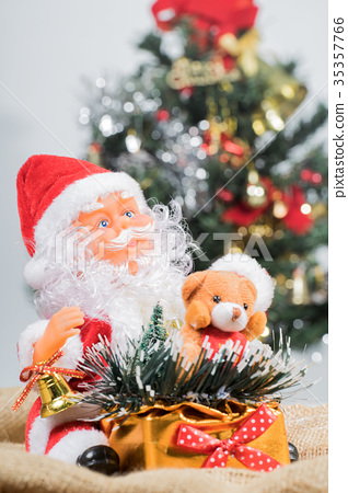 Santa Claus with gift boxes and Christmas tree. 35357766