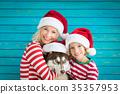 Happy child and dog on Christmas eve 35357953