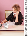 Beauty clinic receptionist at work. 35365663