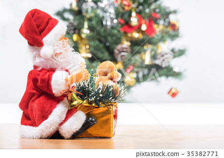 Beside the Santa Claus and Christmas tree  35382771