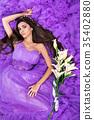 Woman lies on hem of her dress 35402880