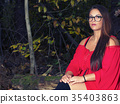 young women stiting forest wearing red dress  35403863