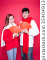 couple holding red envelope 35404913