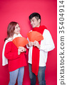 couple holding red envelope 35404914