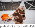 cute girl with sled in snow 35408456