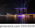 Singapore city at night with laser show  35419349