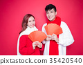 couple holding red envelope 35420540