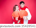 couple holding red envelope 35420541