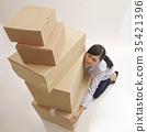 woman lifting boxes 35421396