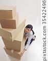 woman lifting boxes 35422496