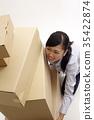 woman lifting boxes 35422874