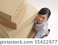 woman lifting boxes 35422977