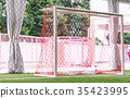 Indoor soccer goal net on artifact grass field 35423995