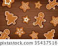 Gingerbread man on wooden table background.  35437516