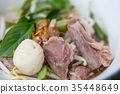 Small noodles with pork and meatballs 35448649