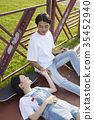젊은여자,젊은남자,스케이트보드 35452940