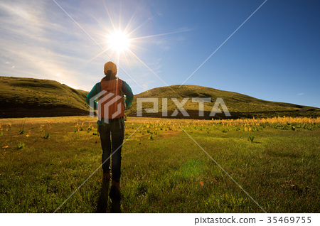 woman hiker with backpack hiking in sunrise  35469755