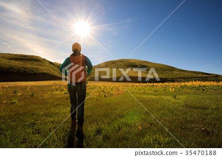 woman hiker   hiking in sunrise wetland 35470188
