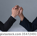 businessman engaged in arm wrestling 35472491