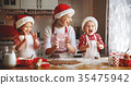 happy family mother and children  bake cookies for Christmas 35475942