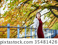Young woman in Paris on a bright fall day 35481426