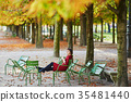 Young woman in Paris on a bright fall day 35481440