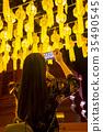 Tourist taking picture of Thai traditional lantern 35490545
