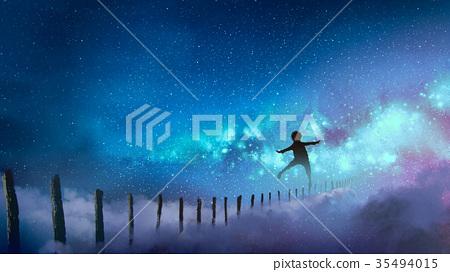 boy balancing on wood sticks against the Milky way 35494015