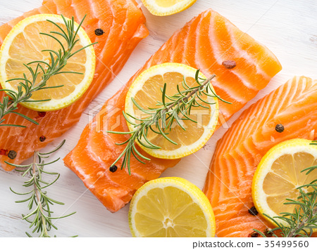 Raw salmon on wooden board with herbs 35499560