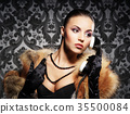 Young, rich and beautiful woman with the retro telephone over the vintage background 35500084