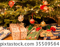 Christmas tree with decorations and present  35509564