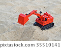 Children's toy  excavator car on sand industrial 35510141
