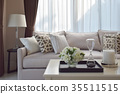 living room with brown sofa and patterned pillows 35511515