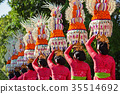Balinese women with religious offering 35514692
