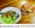 steamed goby with soy sauce and fried egg in soup 35516258